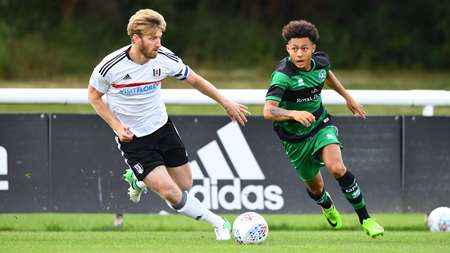 New Under-23s signing Chay Tilt holds off Fulham's Tim Ream