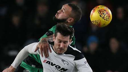 Joel Lynch and David Nugent involved in an aerial challenge