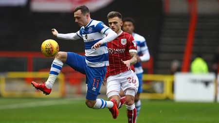 Josh Scowen flies into action as Jamie Paterson watches on