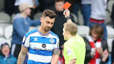 Grant Hall is shown a red card for his second bookable offence