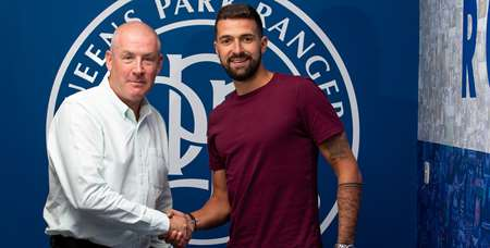 Our new recruit shakes hands with boss Mark Warburton