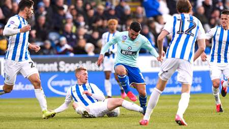 Ilias Chair draws the attention of four Huddersfield defenders