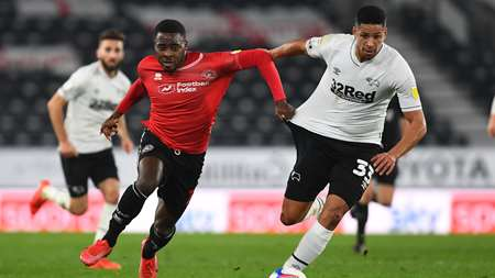 Bright Osayi-Samuel tussles with Derby's Curtis Davies